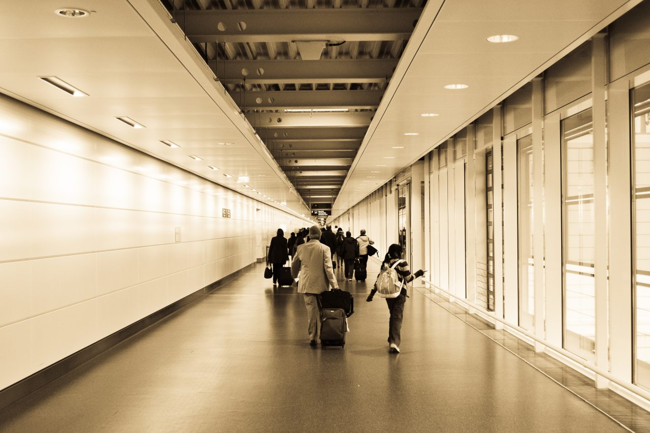 People walking through an airport gate