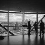 women-business-skyline-window